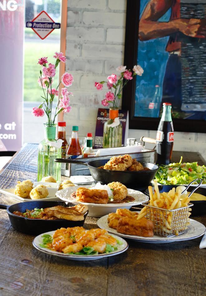 Cajun Phatty's table with food