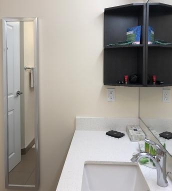 Park Inn YYC Calgary Washroom Shelves Cosmetics Tidy